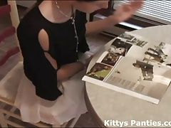Cute teen Kitty reading a magazine