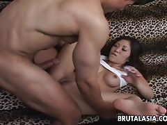 Busty Asian bimbo gets ass...