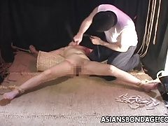 Bound Asian slave gets a full...