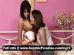 Lovely brunette lesbians kissing...