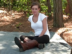 Amy wiggling her riding boots