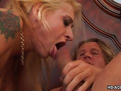 Blonde milf has a nice dick to...