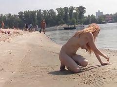 Hot teen blonde plays in the wet...